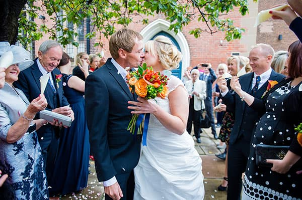 Nottingham Bride and groom confetti kiss
